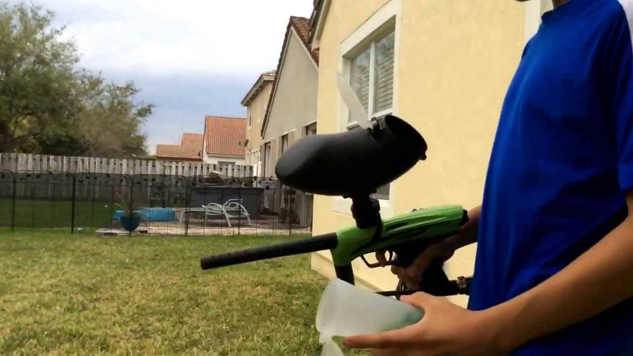 A paintball player testing the range
