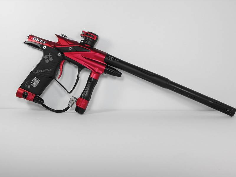 Red Paintball Gun on Table