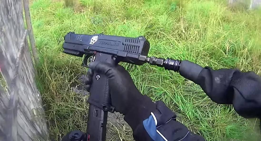 Person Reloading Paintball Gun